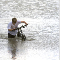 Boy-with-bike-in-floodEA.jpg